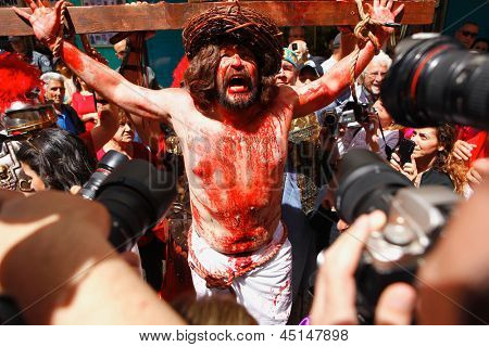 JERUSALEM-MARCH 29: Catholic Holy Friday - a group of actors depicting the crucifixion of Christ near Holy Sepulcher in Old City, Holy Friday March 29, 2013 in Jerusalem, Israel