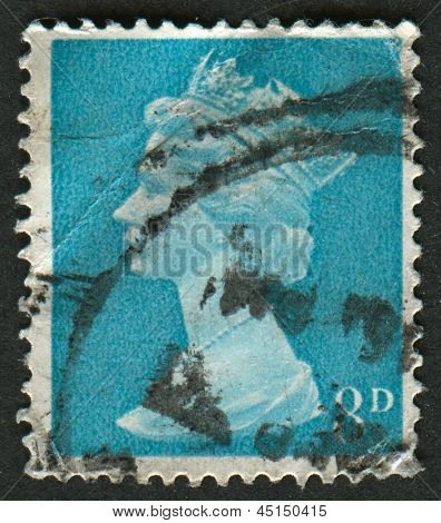 UK-CIRCA 1968:A stamp printed in UK shows image of Elizabeth II is the constitutional monarch of 16 sovereign states known as the Commonwealth realms, in Vermillion, circa 1968.
