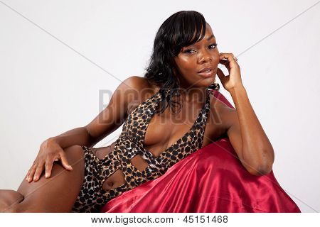 Pretty black woman reclining