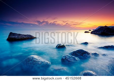Majestic summer sunset over the sea. Dramatic sky. Crimea, Ukraine, Europe. Beauty world.