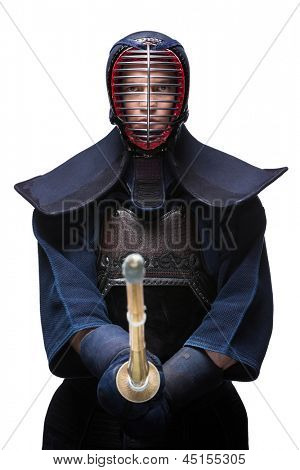 Portrait of equipped kendoka with shinai, isolated on white. Japanese martial art of sword fighting