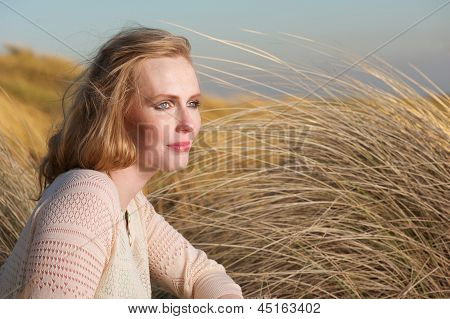 Portrait Of A Beautiful Woman Sitting Outdoors