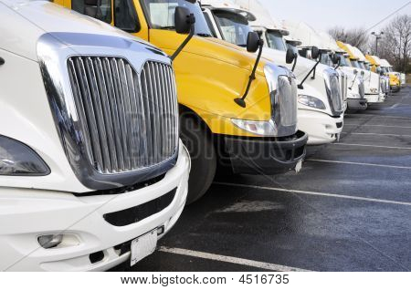 Row Of Large Trucks