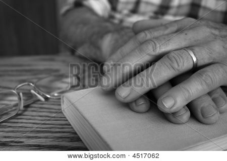 Hands and book