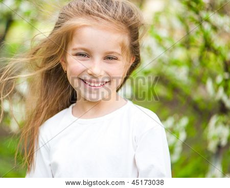 adorable little girl on the meadow in solar  day