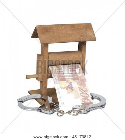 Money laundering. Shekel bill in the wringer with handcuffs isolated over white, clipping path included.