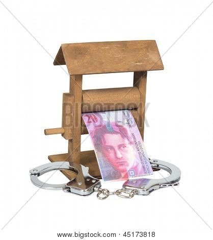 Money laundering. Swiss Franc bill in the wringer with handcuffs isolated over white, clipping path included.