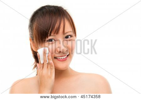 Skin care woman removing face makeup with cotton swab pad, skin care concept. Facial close up of beautiful mixed race Asian. Girl isolated on white background