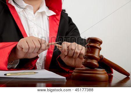 Judge Breaking Pencil