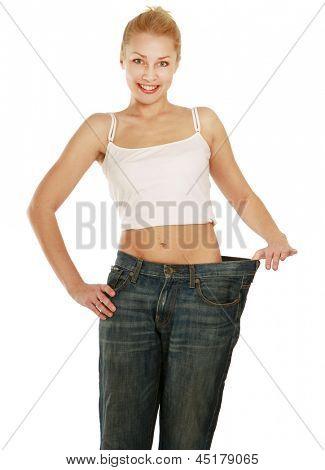Wunderschöne lächelnde Frau zeigen wie viel Gewicht sie verlor, Isolated on white Background-