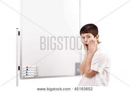 Wonder-struck Little Boy With White Blank Board