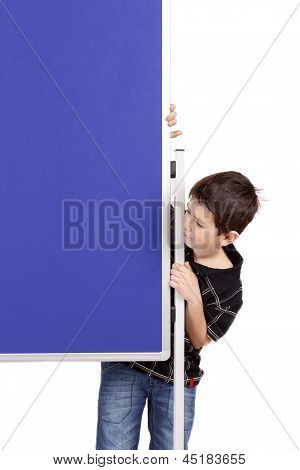 Portrait Of Happy Little Boy With Blue Blank Board
