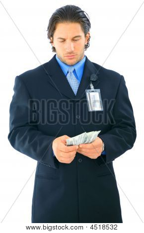 Confused Young Businessman Holding Money