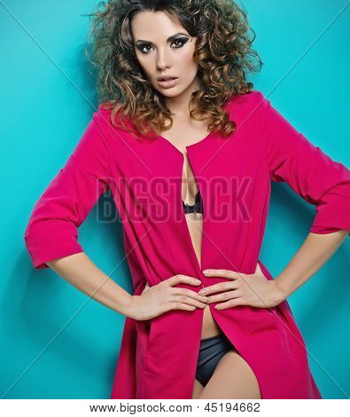 Colorful photo of a woman in pink coat
