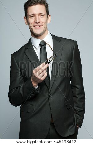 Young handsome businessman in black suit.