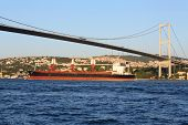 ISTANBUL - JUL 3: Landscape with barge and Ataturk Bridge (Bosphorus Bridge) at sunset on July 3, 20