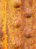 stock photo of ferrous metal  - Close up of rusted riveted sheets of metal - JPG