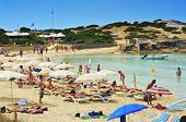 FORMENTERA, SPAIN - SEPTEMBER 18: Bathers in Ses Illetes Beach on September 18, 2012 in Formentera,