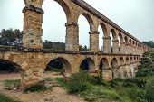 stock photo of aqueduct  - view of the roman aqueduct Pont del Diable Tarragona Spain