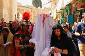 JERUSALEM-MARCH 29: Catholic Holy Friday - a group of actors depicting the crucifixion of Christ nea
