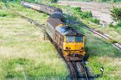 picture of railroad yard  - Passenger train from junction yard is going to the station - JPG