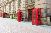 stock photo of west midlands  - Birmingham red telephone boxes - JPG