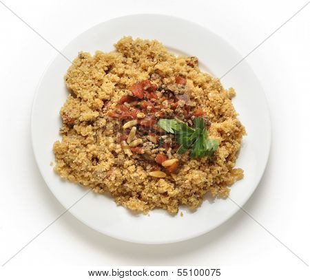 A plate of Lebanese burghul bi banadoura, or cracked wheat with tomatoes. The dish incorporates onion, minced meat and pine nuts, along with the burghul or bulgar wheat from above