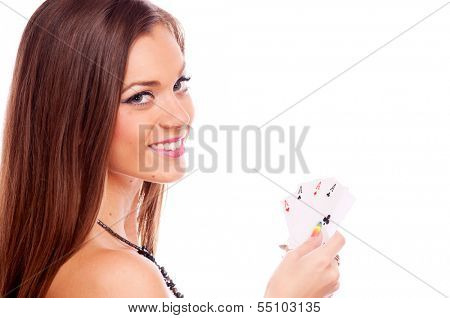 Beautiful brunette holding four aces in her hand - all aces in my hands, isolated on white
