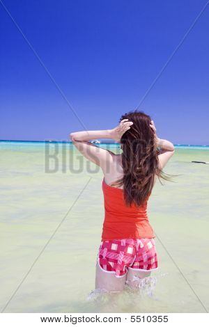 Woman Touching Her Hair In The Water