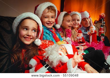 Group of children in Christmas hat with Santa Claus