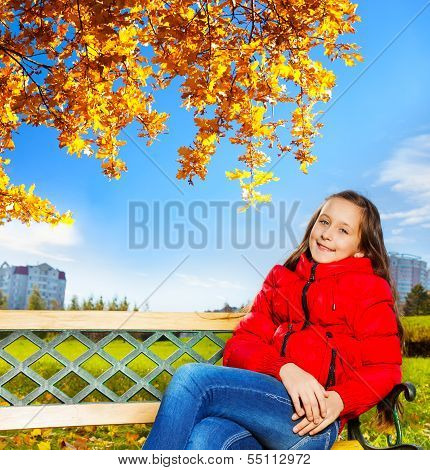 Autumn Portrait On A Girl In The Park