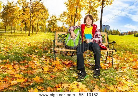 Boy In The Autumn Park After School