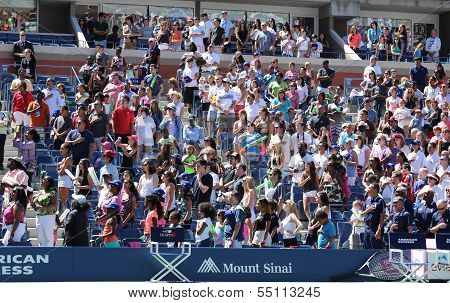 Spectators standing for American anthem performance during opening ceremony for Arthur Ashe Kids Day
