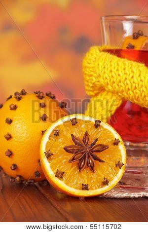 Glass of mulled wine in yellow scarf close-up