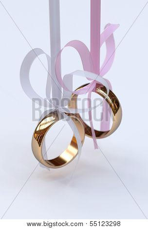 Couple Of Gold Wedding Rings With Bows