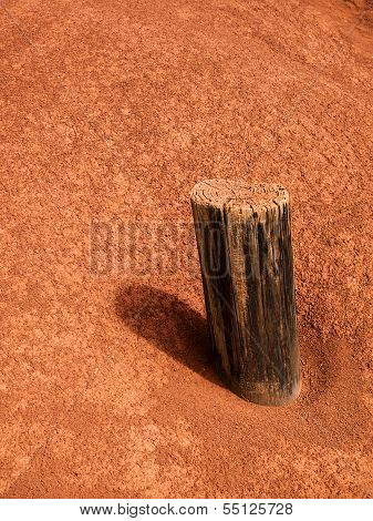 Wood Post On Red Volcanic Soil