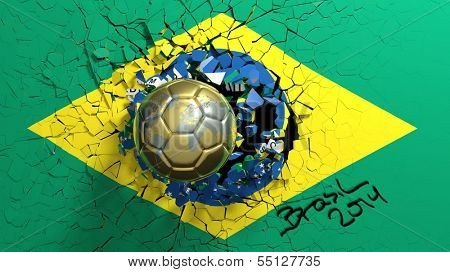 Gold soccer ball breaking though wall with Brazilian flag