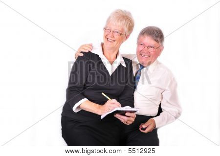 Businessman And Secretary Taking Notes