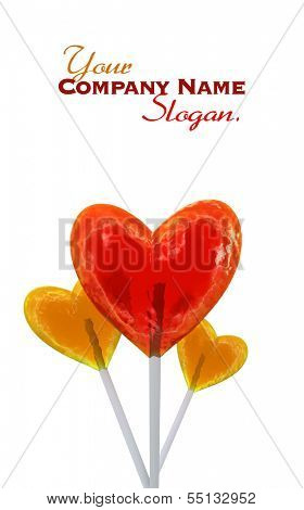 A trio of heart shaped red and yellow lollipops