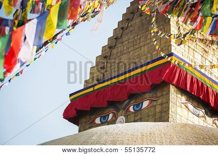 Bodhnath Stupa in Kathmandu with Buddha Eyes and prayer flags.