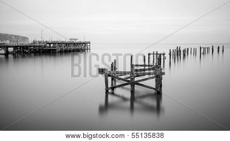 Fine Art Landscape Image Of Derelict Pier In Milky Long Exposure Seascape
