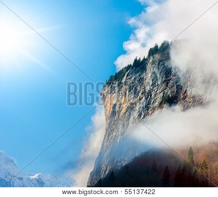 Sun, Clouds And Fog In The Bernese Alps.