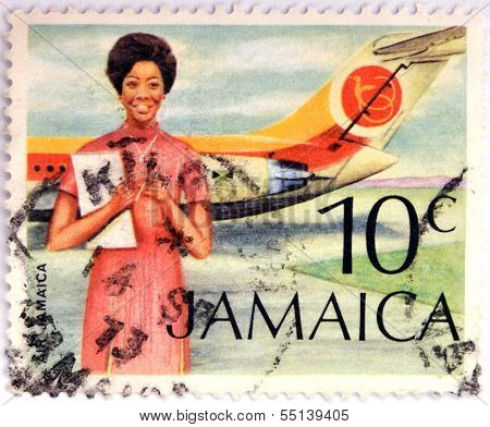 Stamp printed in Jamaica shows A Flight Attendant Standing In Front Of An Air Jamaica Airplane