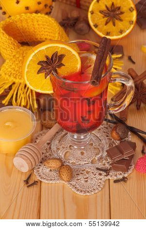 Glass of mulled wine with scarf