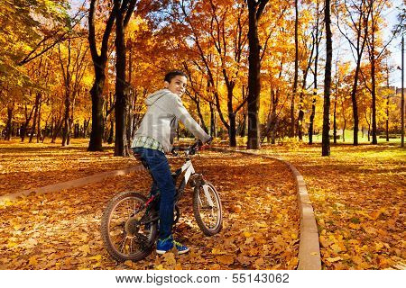 Riding A Bike And Turning Back
