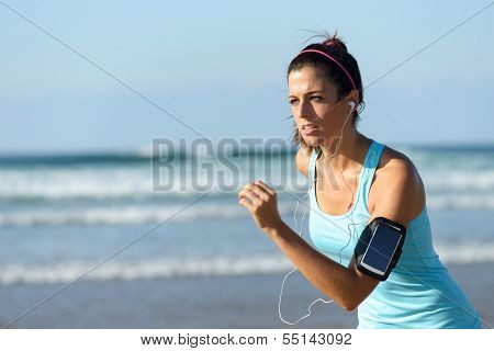 Running With Earphones And Sport Band