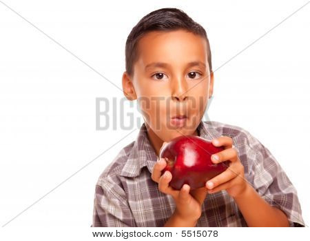 Adorable Hispanic Boy Eating A Large Red Apple