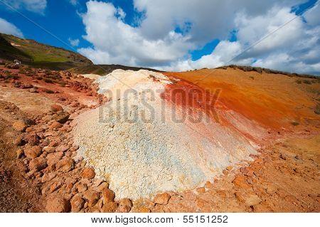 Extremly vivid multicolored land at geaothermal area Seltun near Krysuvik, Reykjanes peninsula - Iceland. Panoramic photo