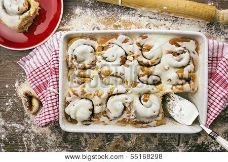 Cake Server Sitting In Cinnamon Roll Baking Dish