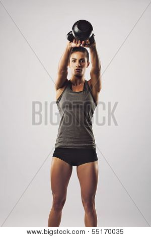 Crossfit Female Working Out With Kettle Bell